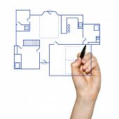 Hand drafting a blueprint for a house