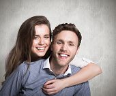 Close up of happy young couple against weathered surface