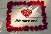 ich liebe dich against frame of rose petals