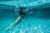 stock photo of playtime  - Girl teenager swimming pool underwater portrait summer playtime - JPG