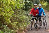 picture of bike path  - Two Mature Male Cyclists Riding Bikes Along Path - JPG