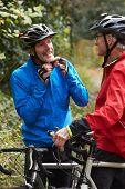 foto of bike path  - Two Mature Male Cyclists Riding Bikes Along Path - JPG