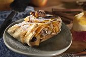 Apple strudel with walnuts and raisins