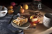 Постер, плакат: Apple strudel with walnuts and raisins