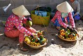 picture of hmong  - Women at vietnam hat selling fruits on the beach - JPG