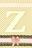Wooden letter Z on polka dots background