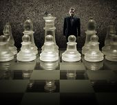 Glass chess board - We are puppets Businessman of the king on the chessboard