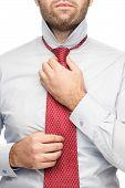 Straightens Necktie