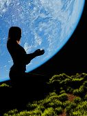 Silhouette of a woman on the background of the planet..