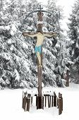 Snow Covered Wooden Cross With Jesus