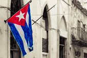 Cuban flag on a grunge decaying neighborhood