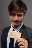 Asian business man holding card writing