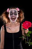 foto of insane  - insane funny female clown with red rose in front of black - JPG