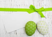 picture of greeting card design  - Easter greeting card with easter eggs on a old wooden background - JPG