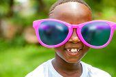 African Boy Wearing Fun Extra Large Sun Glasses.