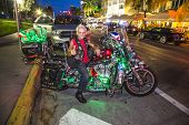 Proud Harley Davidson Biker Poses  At Ocean Drive