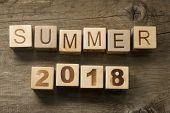 Summer 2018 on a wooden background