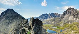 stock photo of siberia  - Clastic rock and a view of the mountain valley - JPG