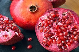 image of pomegranate  - Red fruit Pomegranate on table - JPG