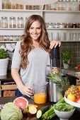 picture of juicer  - Beautiful happy woman making healthy juice with juicer machine - JPG