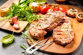 pic of veal  - Grilled veal steaks with vegetables on cutting board - JPG