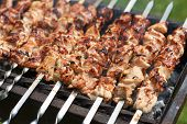 stock photo of barbecue grill  - Grilling shashlik on barbecue grill with delicious meat - JPG