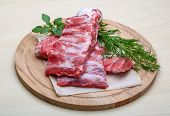 picture of ribs  - Raw pork ribs with dill  - JPG