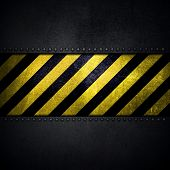 foto of emo  - Detailed abstract metallic background with scratches and stains and yellow and black warning stripes - JPG