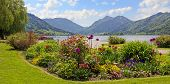 picture of bavarian alps  - pictorial seafront of schliersee lake flower beds and bavarian alps - JPG