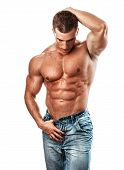 stock photo of hunk  - Muscular handsome sexy guy posing isolated on white - JPG