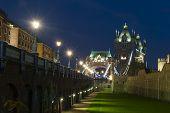 stock photo of london night  - The Tower bridge in London illuminated at night - JPG