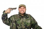 stock photo of cap gun  - Young man in soldier uniform holding gun isolated on white - JPG