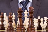 stock photo of chess pieces  - Businessman waiting for playing and chess pieces on chess table - JPG