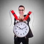 stock photo of time-bomb  - Man with time bomb isolated on white - JPG