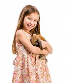 picture of rabbit year  - cute smiling girl in a summer dress with a baby rabbit on white - JPG