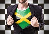foto of rastafari  - Businessman stretching suit with Jamaica Flag on checkered background - JPG