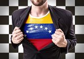 image of civil war flags  - Businessman stretching suit with Venezuela flag on checkered background - JPG