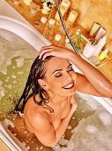 pic of bubble bath  - Young woman washing hair and take bubble  bath - JPG