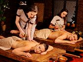 stock photo of massage oil  - Couple  having oil Ayurveda spa treatment - JPG