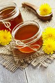 picture of jar jelly  - Jelly of dandelions in a glass jar on the table - JPG