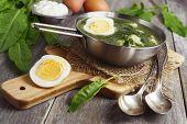 foto of sorrel  - Sorrel soup with egg on wooden table - JPG