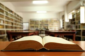 foto of librarian  - Old book and book shelfs in a library - JPG