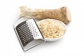 image of grated radish  - grated horseradish root on white background - JPG