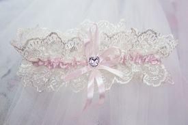 stock photo of garter-belt  - Beautiful wedding white bridal garter - JPG