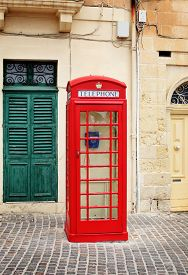 stock photo of phone-booth  - Traditional red phone booth in Malta - JPG