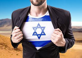 foto of israel people  - Businessman stretching suit with Israel on desert background  - JPG