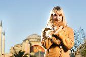 Beautiful blond girl in lambskin coat (Turkey, Istanbul)