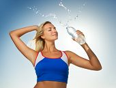 image of drinking water  - Young woman drinking water after fitness exercise - JPG