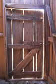 pic of tobacco barn  - an old dilapidated wooden tobacco barn door - JPG