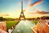 Paris. Eiffel Tower and fountain at Jardins du Trocadero at sunrise, Paris, France. Beautiful Romant poster